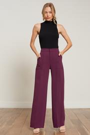 Features Polyester/Spandex blend Fully Lined Invisible zipper & button closure Full two pocket pant Wide leg